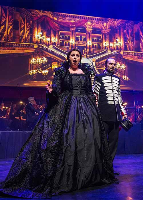 Raoul with Mme Giry in Masquerade staged in Iceland at the Harpa Theatre.